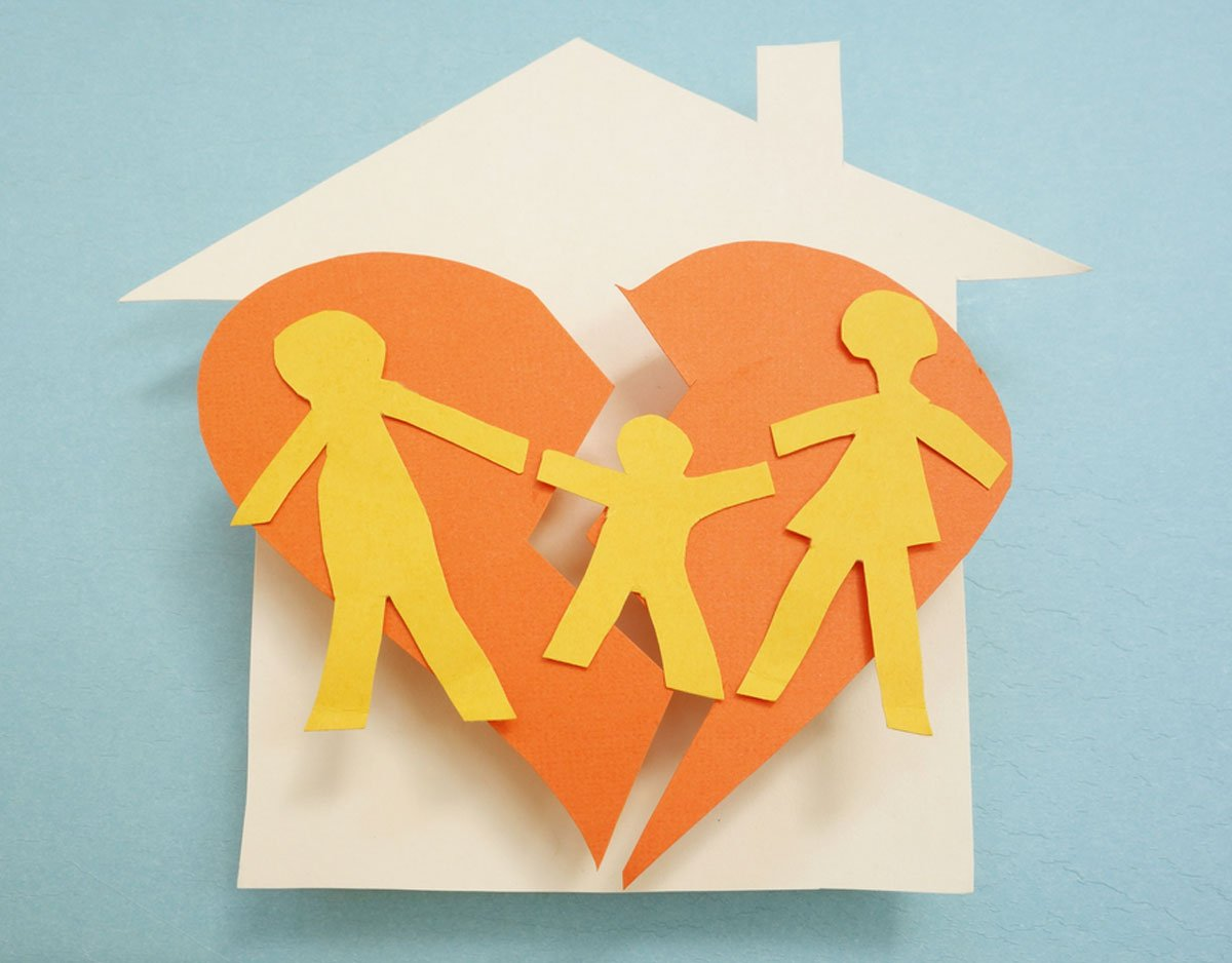 cutout of house and broken family