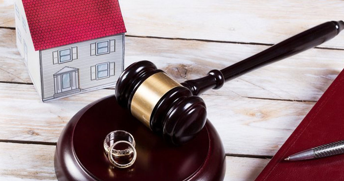 home model on top of divorce papers