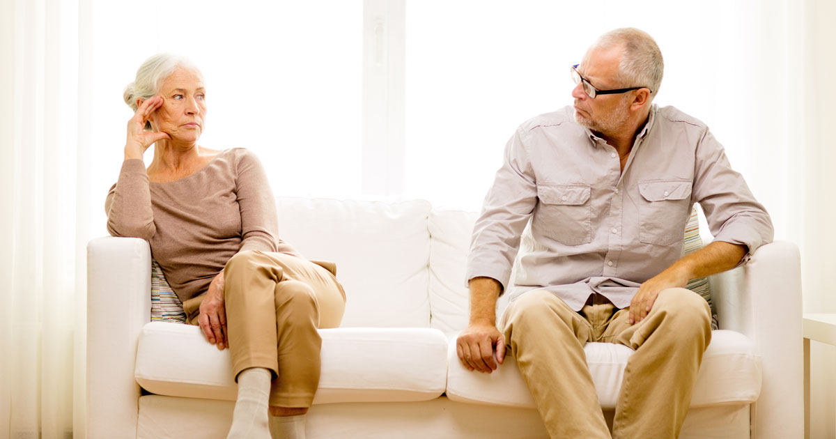 elder couple looking at each other with hate