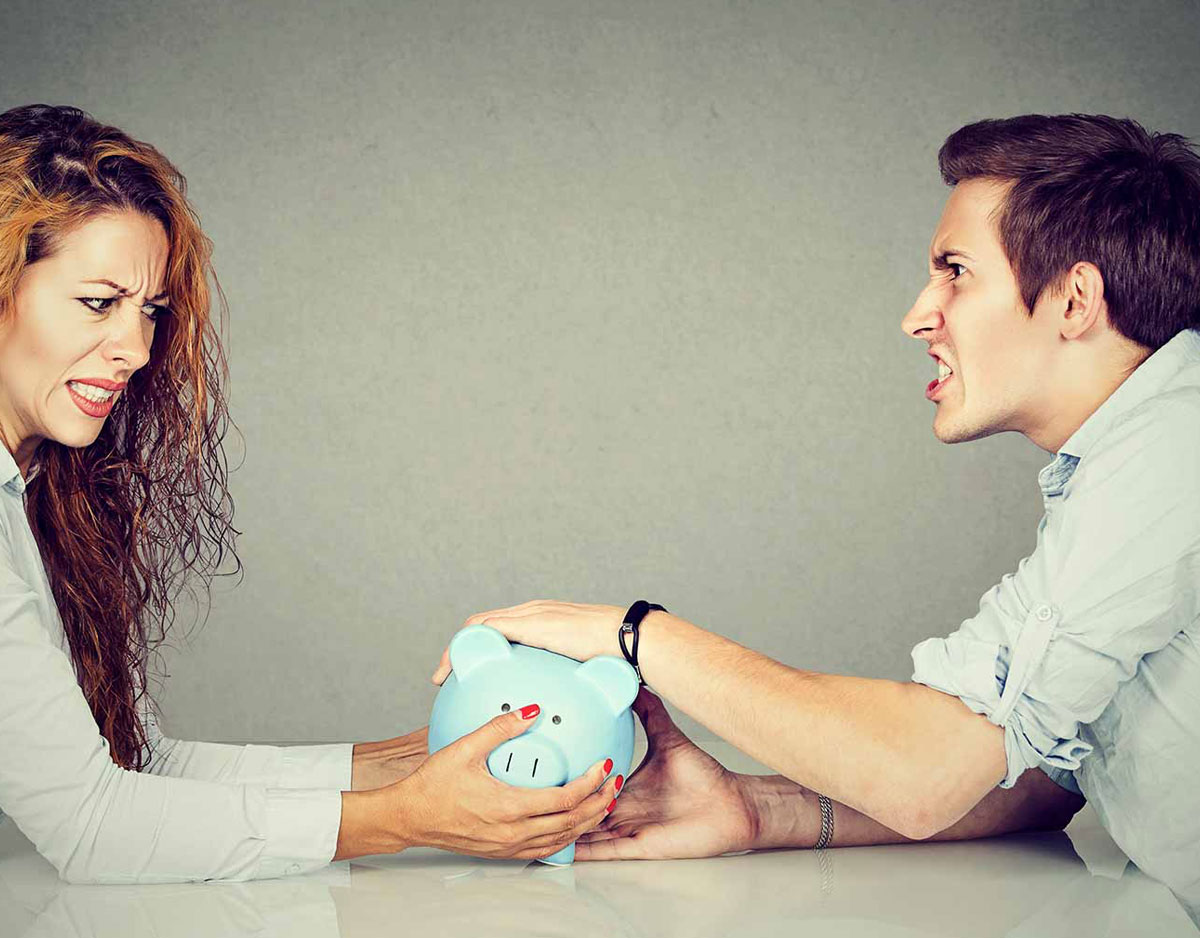 couple fighting over piggy bank