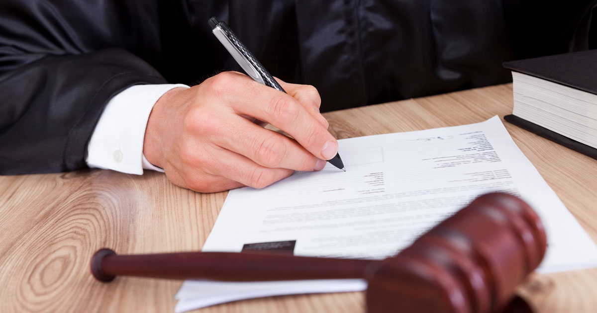 judge signing papers