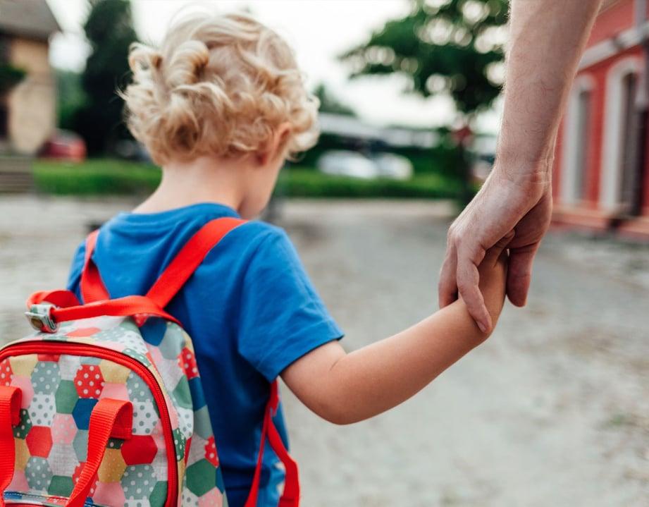 kid holding hand