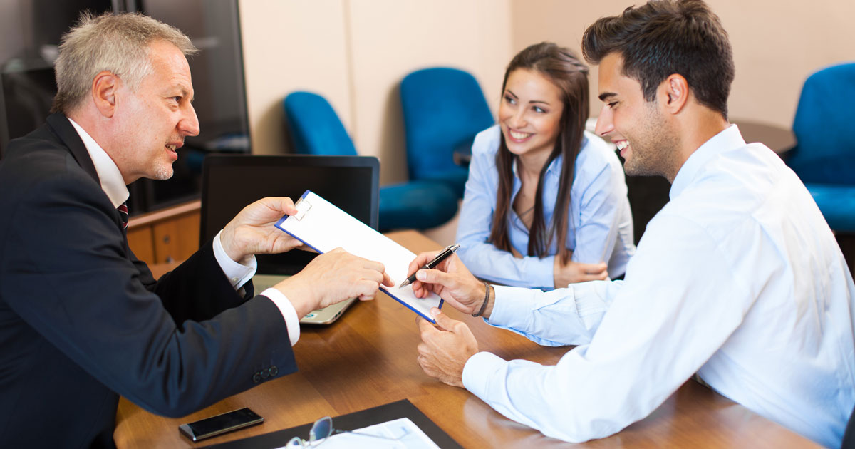 lawyer showing agreement to couple