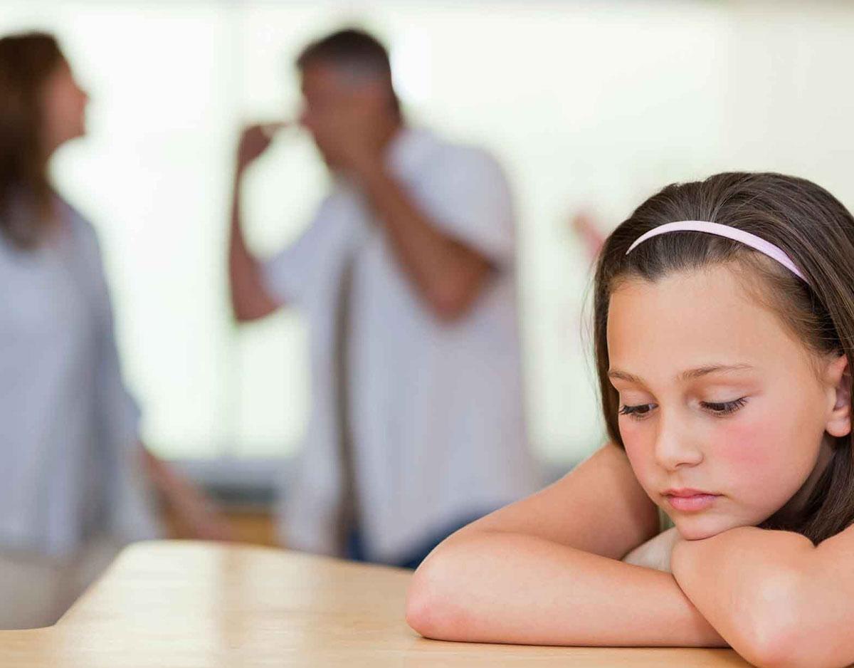 sad child fighting parents